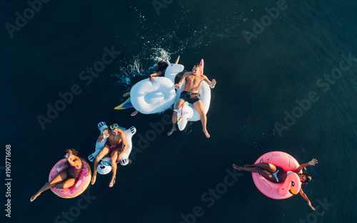Fotobehang Hoogte schaal Group of friends having fun on the beach