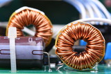 Inductor copper coil on circuit board - 190774237
