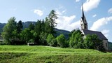 Timelapse of traditional tyrolean church in small Italian village - 190784213
