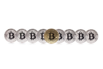 Set of bitcoins with a golden bitcoin on the front as the leader, isolated on a white background