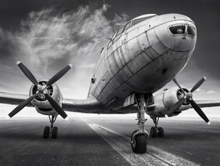 historical airplane on a runway