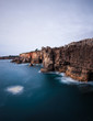 Panoramic view of cliff and sea in the Portuguese coastline. Long exposure