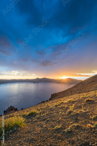 Sunbursts Over The Rim Of Crater Lake