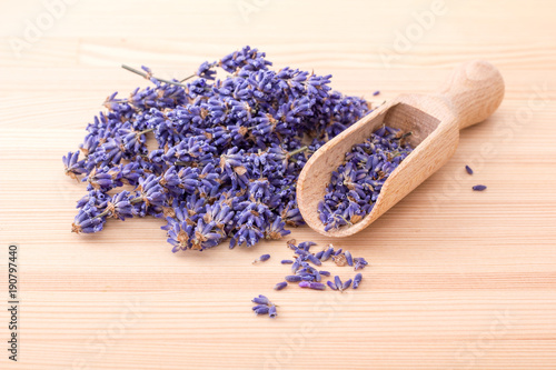 Fotobehang Lavendel dried lavender flowers / Wooden spoon with dried lavender flowers