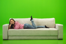 The Smile Woman Lay On The Sofa On The Green  Sticker