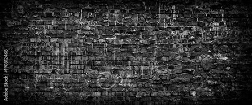 Black grunge brick wall panoramic background.
