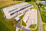 Aerial view of warehouse with trucks. Industrial background. Logistics from above.  - 190820810