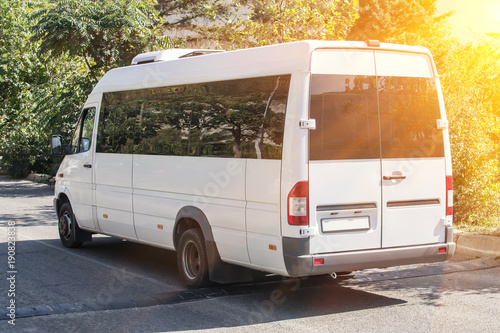 Fototapeta minibus goes on the country highway
