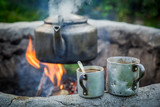 Hot and aromatic coffee with kettle on bonfire - 190825848
