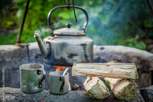 Freshly made coffee with kettle on campfire - 190825813
