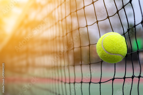 Fotobehang Tennis Tennis ball hitting to net on blur court background