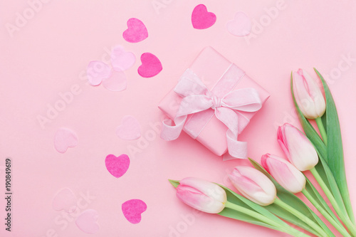Plagát Spring flowers and present or gift box on pink pastel table top view