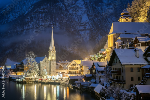 Hallstat village in the Austria at the evening time. Beautiful village in the mountain valley near lake