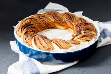 Brioche with cinnamon, baking, horizontal