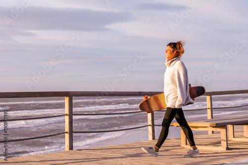 Fotobehang Skateboard Girl holding a skateboard