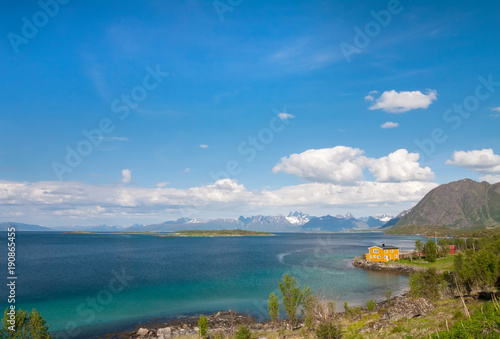 Tuinposter Blauwe jeans fjord, snow mountains and house, Norway, Lofoten