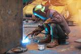 Welders working with metal