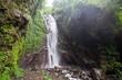 Woman feels the fresh from the Git git waterfall in Bali, Indonesia - 190873283