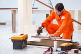 Contractor working on laminate wooden floor - 190876490