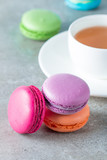 Photo of cake macarons, gift box, tea, coffee, cappuccino and flowers. Sweet romantic food macaroon concept. Morning breakfast and presents. - 190887417
