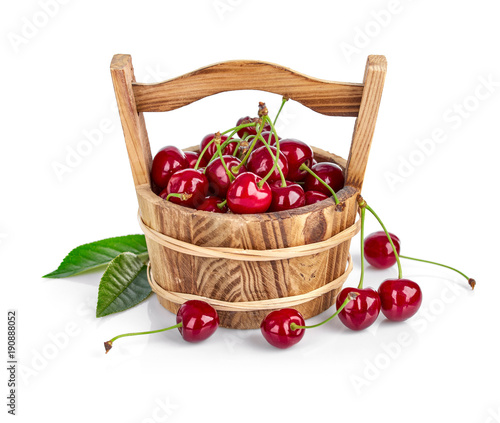 Fotobehang Kersen Fresh cherry berries with green leaf isolated on white
