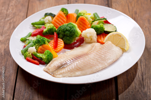 plate of fried fish fillet with vegetables