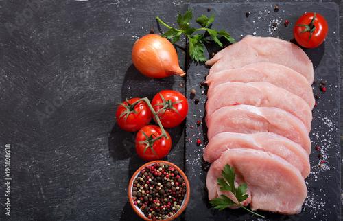 fresh turkey meat on wooden board