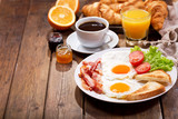 breakfast with fried eggs, croissants, juice, coffee and fruits - 190898828