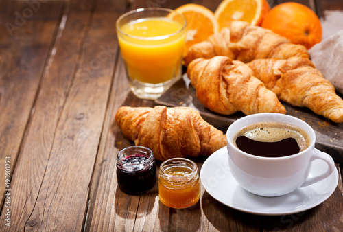 Sticker breakfast with cup of coffee and croissants