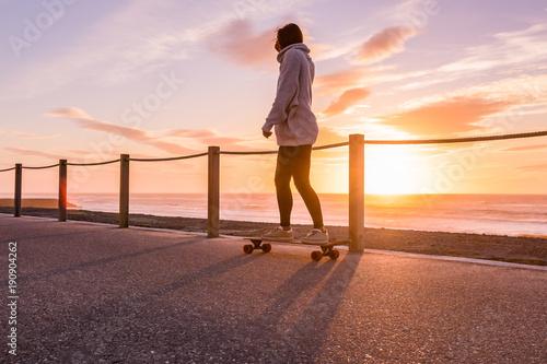 Fotobehang Skateboard Girl riding a skateboard