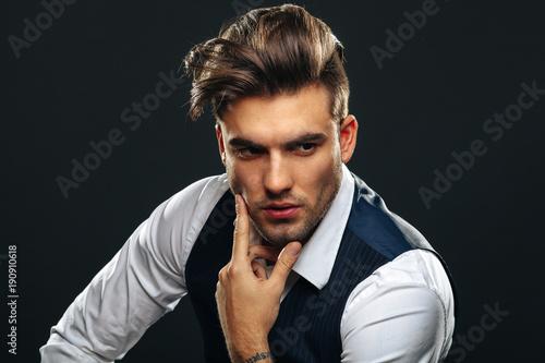 Foto Murales Portrait od handsome man in studio on dark background
