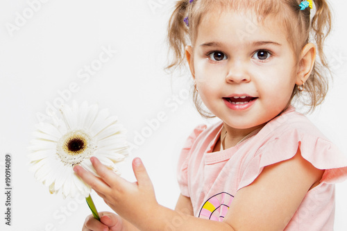 Portrait of a beautiful little cheerful girl on a white background