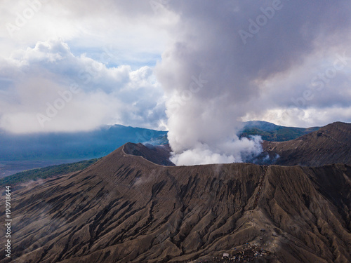Aluminium Bleke violet Mount Bromo (Gunung Bromo) active volcano crater and part of the Tengger massif. Aerial top view from drone. East Java, Indonesia
