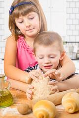 happy children doing bread homemade