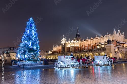 fototapeta na ścianę Krakow, Poland, Christmas tree and Cloth Hall on Main Market square