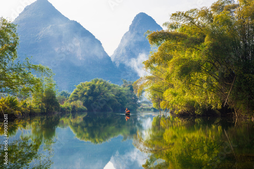 Fotobehang Guilin Amazing natural landscape. Beautiful karst mountains reflected in the water of Yulong river, in Yangshuo, Guangxi province, China.