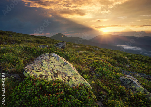 Mountain valley during sunrise. Natural summer landscape..