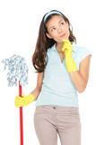 Thinking cleaning woman looking to the side pensive. Beautiful cleaning maid holding mop for spring cleaning isolated on white background. Multiracial Asian / Caucasian cleaning lady. - 190933429