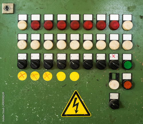 control panel with several unlabeled buttons