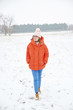 Quadro Full length shot of a happy woman enjoy winter weather outdoor and walking alone.