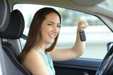Happy car owner holding keys looking at camera - 190954041