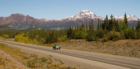 Vintage Car Travels North Highway Alaska Mountain Range Transportation