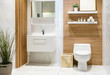 Modern spacious bathroom with bright tiles with toilet and sink. Side view - 190974692