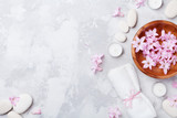 Aromatherapy, beauty, spa background with massage pebble, perfumed flowers water and candles on stone table top view. Relaxation and zen like concept. Flat lay. - 190992097
