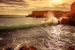 Quadro Beautiful seascape, a wave is broken against a rocky coast at sunset, tropics, vacation, travel background. Algarve, Portugal