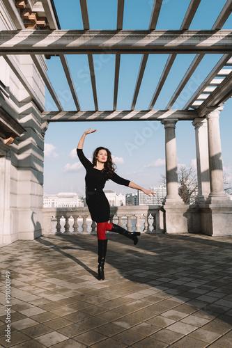 Carefree traveler woman posing in city