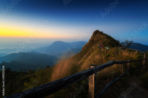 In de dag Nachtblauw Morning mist and mountains. Mountain View.High angle view at Doi Phu Chi Dao Scenic spot inWiang Kaen District, Chiang Rai,Thailand.