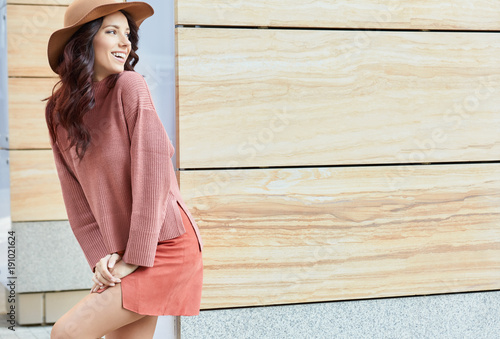 Portrait of fashionably dressed woman in hat. Beauty concept