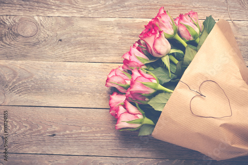 Bouquet of red roses on wooden background -  Vintage look - 191024855