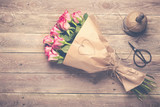 Bouquet of red roses on wooden background -  Vintage look